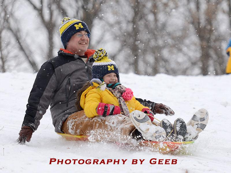 Steve and Maya having fun sledding