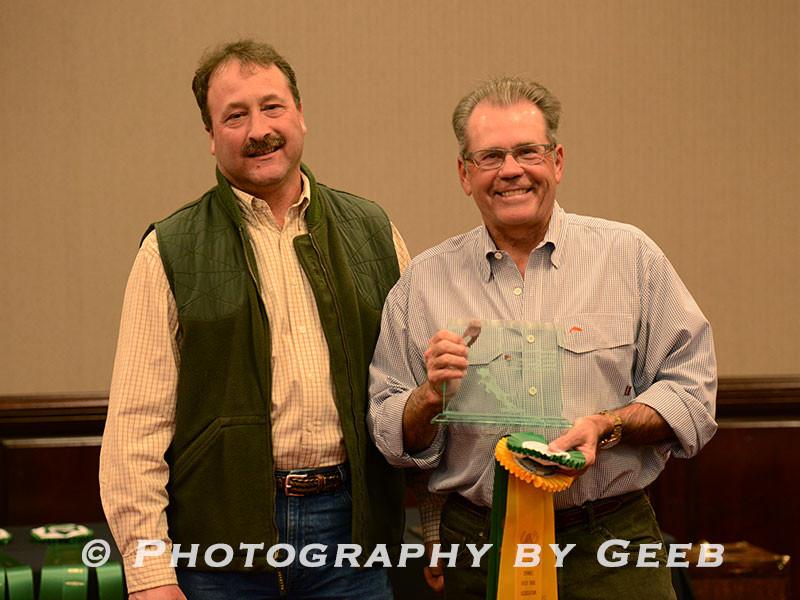 Dave Barto presenting the guns award to Bob Montler (#112 Treva)